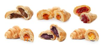 Set with fresh tasty croissants and different fillings. On white background royalty free stock photo
