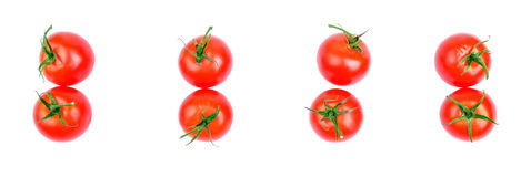 Set of fresh tomatoes, isolated on white background, top view. A group of tomatoes with leaves for salad. Tomatoes from the garden Stock Photo