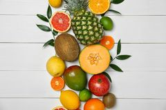 Set of fresh tropical fruits on wooden background. Set of fresh tropical fruits on white wooden background Royalty Free Stock Photos