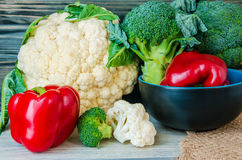 Set of fresh vegetables. Broccoli, pepper and other vegetables closeup on wooden background Stock Photo