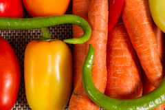 Set of fresh vegetables. Green chili peppers , sweet peppers , carrots and tomatoes Royalty Free Stock Photo