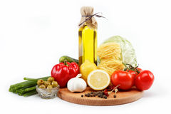 Set fresh vegetables with olive oil isolated. Royalty Free Stock Photography