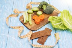 A set of fresh vegetables on a wooden table. The concept of a healthy diet.  Royalty Free Stock Photo