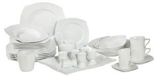 Set of fresh washed plates and dishes. Isolated on white Royalty Free Stock Image
