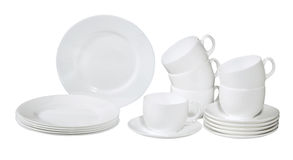 Set of fresh washed plates and dishes Royalty Free Stock Image