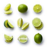 Fresh lime isolated on white background. Set of fresh whole and cut lime and slices isolated on white background. From top view royalty free stock images