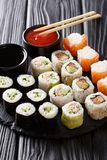 Set of freshly prepared rolls with various fillings close-up wit Stock Photos