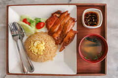 Set of fried rice garlic with grilled chicken teriyaki and soup with spoon and fork in the wooden tray Stock Images