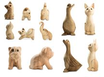 Set of front and beside of animal. Set of front and beside of Cat, Duck, Dog and Elephant carved wooden dolls with white background stock photos
