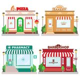 Set of front facade buildings: bakery, barbershop, pizzeria and pharmacy with a sign and symbol in shopwindow. Flat style. Vector illustration vector illustration