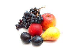 Set of fruit. Grapes, a peach, a pear, an apple, plum on a white background Royalty Free Stock Images