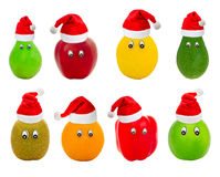 Set of fruit with eyes in red hats of Santa Claus Royalty Free Stock Images