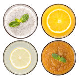 Set of fruit smoothie and fruit juice in glasses isolated on whi Stock Photos
