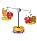 Set of fruits and vegetables on scales Stock Photo