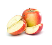 Apple cut to half and a quarter Royalty Free Stock Photography