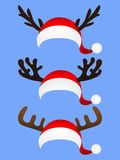 Set of funny hat  Santa Claus with reindeer horns Royalty Free Stock Image