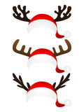 Set of funny hat  Santa Claus with reindeer horns on a white b Stock Photo