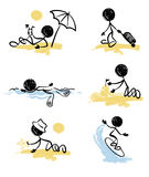 A set of funny little men - on the beach Stock Photography