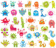 Set of funny little monsters. Big Set. Set of funny little monsters. Seamless ornament. Funny cartoon character. Vector illustration. Isolated on white Royalty Free Stock Photo