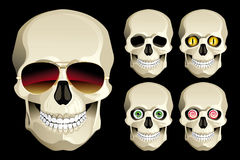 Set of funny skulls with different eyes and glasses. Vector set of funny skulls in different eye lenses and one skull sunglasses Royalty Free Stock Photography