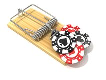 Set of gambling casino chips, like bait, in wooden mousetrap Stock Photography