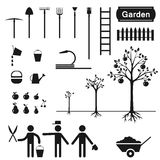 A set of garden elements and garden tools . Simple silhouettes of gardener trees and garden tools Stock Images