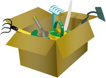 Set of garden tools in the cardboard box Royalty Free Stock Photo