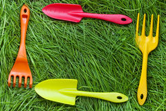 Set of gardening tools on grass Royalty Free Stock Photos