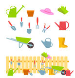 Set of gardening tools on white and composition with a fence Stock Image