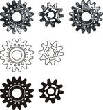 Set of gears. Textural pictures. Two kinds of gears in various graphic execution Royalty Free Stock Photo