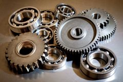 Set of gears and ball-bearings. On black background royalty free stock images