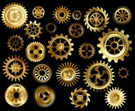 Set of gears. Set of gold and brass gears on a black background Royalty Free Stock Photos