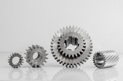 Set of gears on grey background. Set of gears on isolated grey background Stock Images