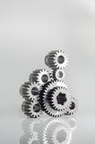 Set of gears on grey background. Set of gears on isolated background Royalty Free Stock Image