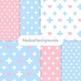 Set of gentle medical backgrounds. Six blue and pink seamless backgrounds with medical theme. Vector illustration Vector Illustration