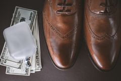 Set of gentlemen. Shoes with perfume and dollars royalty free stock photography