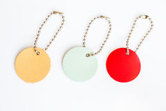 Set of genuine leather circle tags on white background Stock Photography