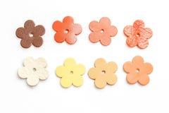 Set of genuine leather flowers on white background Royalty Free Stock Photo