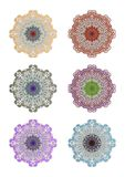 Set of geometric circle lace ornaments in different color variants. Stock Photos