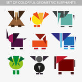 Set of geometric colorful elephants. Geometric colorful dogs on a light background Royalty Free Stock Photography