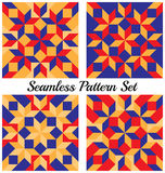 Set of 4 geometric seamless patterns with rhombus and squares of blue, red and orange shades Royalty Free Stock Image