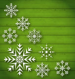 Set geometric snowflakes on wooden background Stock Image