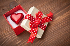 Set of gift box with hart. On wooden background stock images