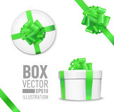 Set of  gift box. White round gift box with shiny green beautiful curly bow and ribbon. Top view, side view.  on blue Background Royalty Free Stock Image