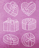 Set of  gift boxes. Set of  gift boxes with bows and ribbons. On watercolor backdrop Stock Photo