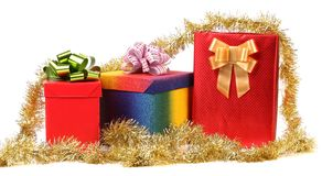 Set of gift boxes and gold tinsel. Stock Image