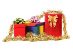 Set of gift boxes and gold tinsel. Stock Photo