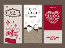 Set of gift cards, hand-drawn. Templates gift certificate. To shop. Coupon code with the texture of wood, ribbon and bow for the holidays and Valentine Day Stock Photo