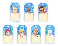 Set of gift tags with kids. Collection of five gift tags with smillig children on winter background Royalty Free Stock Images
