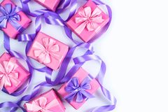 A set of gifts for a newborn pink color on a white background A top view of Flat lay Copy space horizontal Selective focus. A set of gifts for a newborn pink stock photos